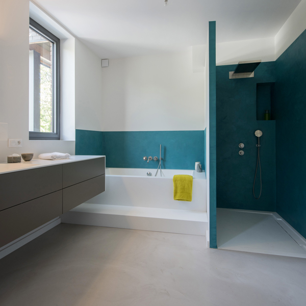 Bathroom with decorative concrete on floor and walls